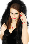Brunette in a fur hood — Stock Photo