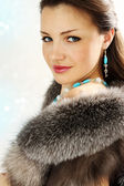 Brunette in the furs — Stock Photo