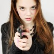Girl holding a gun — Stock Photo