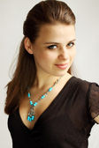 Woman in turquoise — Stock Photo