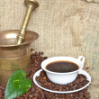 Coffee beans and antique coffee mill — Stock Photo