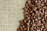 Sack and coffee beans background — Photo