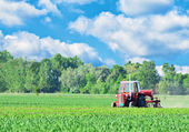 Tractor on beautiful landscape — Stock Photo
