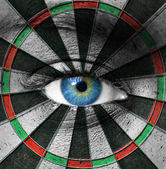 Blue eye and dartboard — Stock Photo