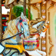 Carousel - Fair conceptual background with horses — Stock Photo #10550045