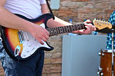 Man playing guitar closeup — Stock Photo