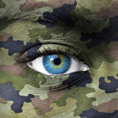 Army camouflage colors on human face — Stock Photo