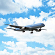 Airplane against blue sky — Stock Photo #8518785