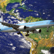 Stock Photo: Airplane circling globe - Travel concept