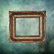 Empty golden frame on grunge old wall — Стоковая фотография