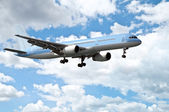 Airplane in blue sky — Stock Photo