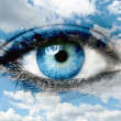Stock Photo: Blue eye and blue sky - Spiritual concept