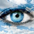 Blue eye and blue sky - Spiritual concept — Stock Photo