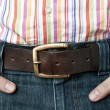 Jeans leather belt and shirt with hands in pocket — Stock Photo