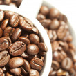 Coffee cup filled with coffee beans — Stock Photo #8524925