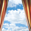 Window curtains with view of clouds and sky — Stock Photo