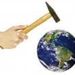 Human hand holding hammer and threatening to destroy planet Eart — Stock Photo #8525691