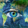Planet earth and blue human eye — Stock Photo #8526409
