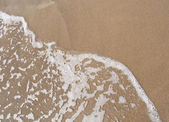 Beach sand and wave — Stock fotografie