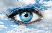 Blue eye and blue sky - Spiritual concept — Stock Photo