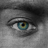 Blue eye on canvas pattern — Stock Photo