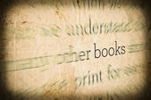 "Grunge background with word ""BOOKS"" in center — Stockfoto"