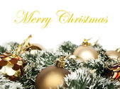 Christmas decoration with golden ornaments isolated on white — Stock Photo