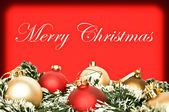 Elegant Christmas background with red and golden ornaments — Stock Photo