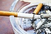 Burning cigarette in ashtray — Stock Photo