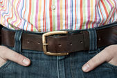 Jeans leather belt and shirt with hands in pocket — Zdjęcie stockowe