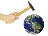 Human hand holding hammer and threatening to destroy planet Eart — Stockfoto
