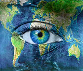 Planet earth and blue human eye — Stock Photo