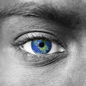 Planet earth in blue human eye — Stock Photo