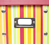 Colorful paper box with empty tag — Stock Photo