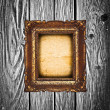 Royalty-Free Stock Photo: Vintage golden frame on wooden wall