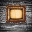 Stock Photo: Antique golden frame over wooden wall