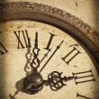 Vintage clock on grunge background — Stock Photo
