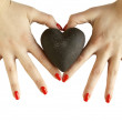 Stock Photo: Woman's hands holding heart - heart shape