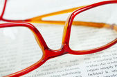 Glasses on business papers macro — Stockfoto