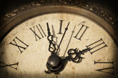 Antique clock on grunge background — Stock Photo