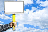 Man holding blank sign over blue sky with space for your text — Stock Photo