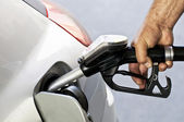 Close-up of a mens hand refilling the car with a gas pump — Stock Photo