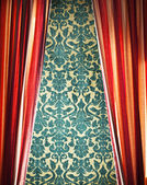 Red curtain with damask wall — Stock Photo