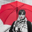 Beautiful woman with red umbrella and red lipstick — Stock Photo