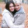 Two girls hugging in nature - Friendship concept — Stock Photo