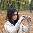 Royalty-Free Stock Photo: Beautiful girl taking photo with camera