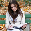 Beautiful girl studying outdoors — Stock Photo