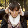 Close-up of a beautiful woman listening music outdoor — Stock Photo