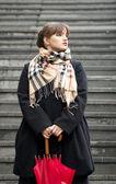 Young beautiful girl posing outdoors with umbrella — Stock Photo