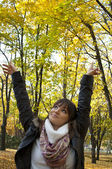 Portrait of a happy woman in autumn forest — Stock Photo
